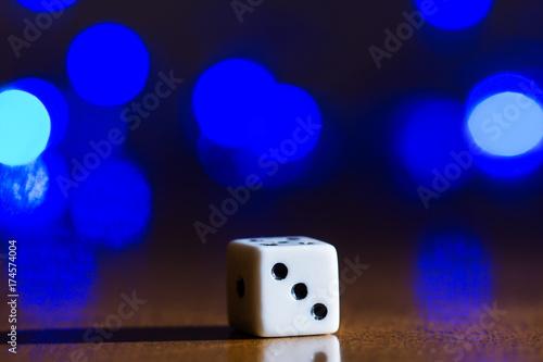 playing cube on a dark background плакат