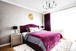 Spacious bedroom with modern furniture design, double bed and warm colors