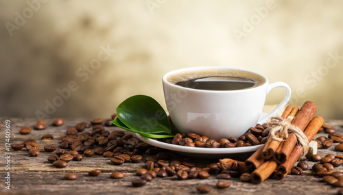 Wall Murals Cafe Coffee cup and saucer on a wooden table. Dark background