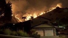 House Surrounded By Wildfire