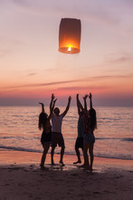 Friends Releasing Lantern At B...