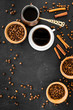 Brew coffee in turkish coffee pot. Black background top view copyspace