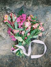 Pink Bridal Bouquet On Grey Ocean Rock