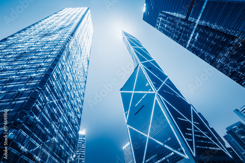 Photo  directly below of modern financial skyscrapers in central Hong Kong,blue toned,china