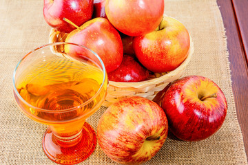 Apple cider glass and red apples