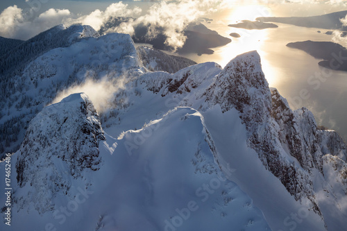 Papiers peints Beige Aerial landscape view of Lion Mountains in Vancouver North Shore near Howe Sound, British Columbia, Canada.