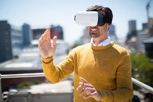 Man Using Virtual Reality Headset In Balcony