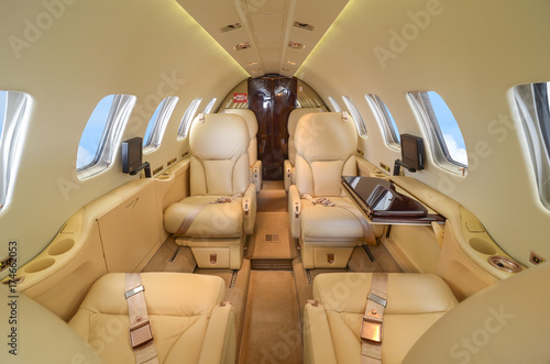 Fényképezés  Luxury interior of genuine leather in the modern business jet and sunlight at th