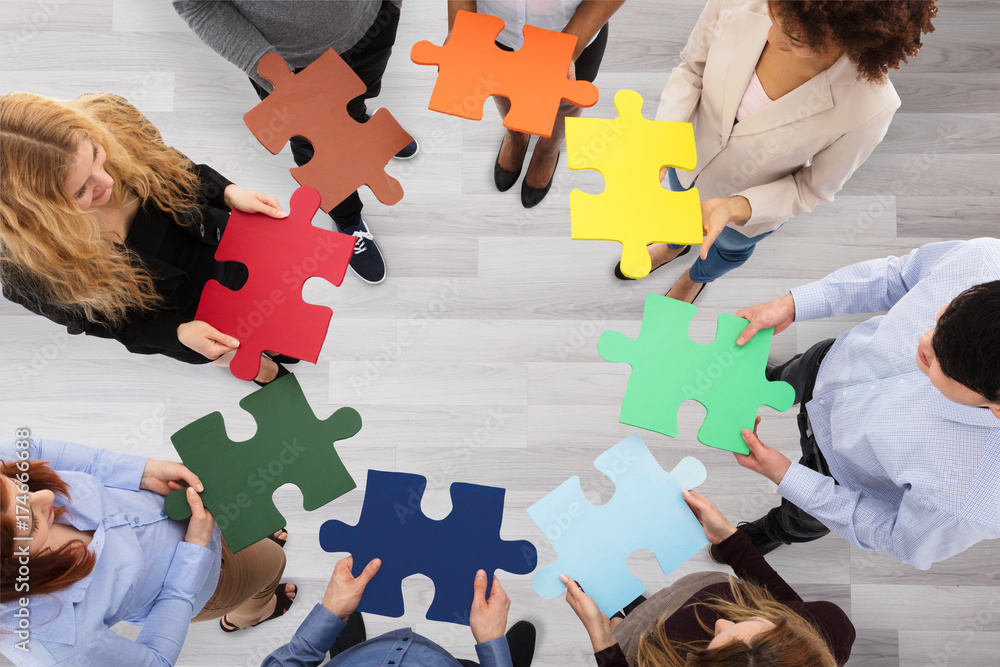 Fototapeta Group Of Business People Holding Colorful Jigsaw Puzzles