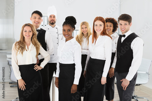 Portrait Of Confident Restaurant Staff Canvas Print