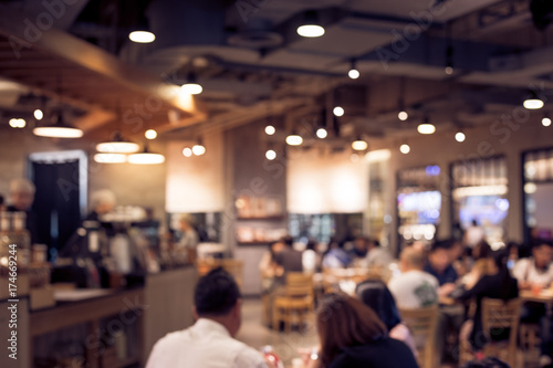 Poster Restaurant Blur coffee shop or cafe restaurant with abstract bokeh light.background idea
