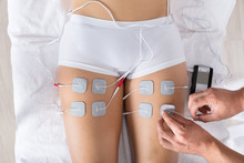 Therapist Giving Electrodes Th...
