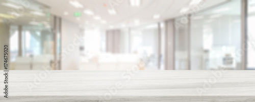 Obraz Marble stone tabletop and blurred bokeh office interior space background - can used for display or montage your products. - fototapety do salonu