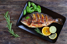 Grilled Whole Fish On Black Plate