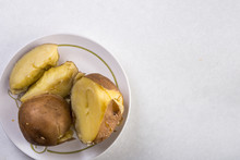 Flat Lay Above Served Cooked Potatoes Above White Marble Background