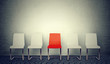 Leinwanddruck Bild - One opening for the job concept. Row of white chairs and one red in the middle