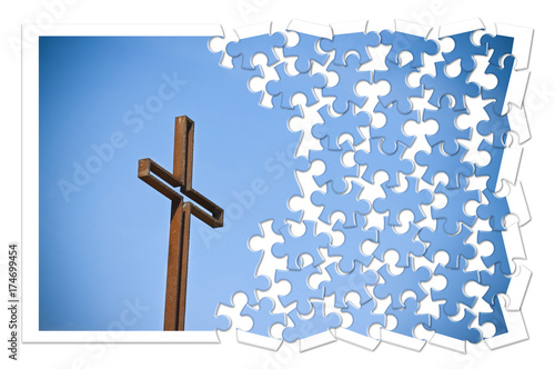 Rusty iron cross against a blue background - Rebuild our faith - Christian cross concept image in jigsaw puzzle shape Billede på lærred
