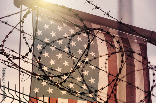 American flag and barbed wire, USA border Canvas Print