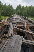 Broken Wooden Bridge Across Th...