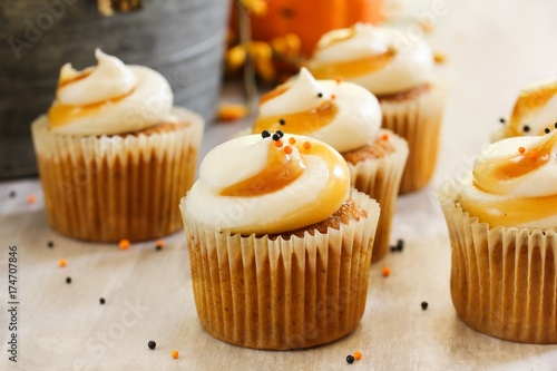 Mini Pumpkin spice cupcakes on autumn background, selective focus Canvas Print