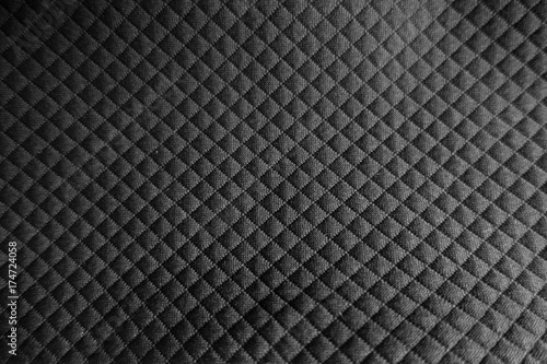Fototapeta Surface of black fabric with embossed squares