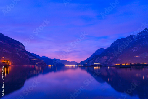 Poster Dark blue Central Switzerland, Lake Lucerne. Night landscape. Royal blue. The mountain range, the light of lanterns and lamps are reflected in the lake, long exposure