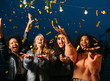 canvas print picture Happy women throwing confetti in the air. Friends celebrating outdoors.