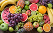 Leinwandbild Motiv Organic fruits background. Healthy eating concept. Flat lay.