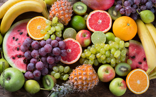 Photo Stands Fruits Organic fruits background. Healthy eating concept. Flat lay.