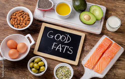 Fototapeta Selection of healthy fat sources on wooden background obraz
