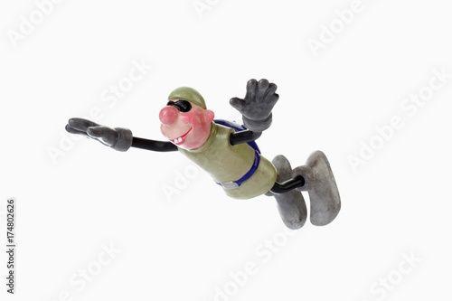 Fotografie, Tablou  Cartoon character, basejumper in updraft