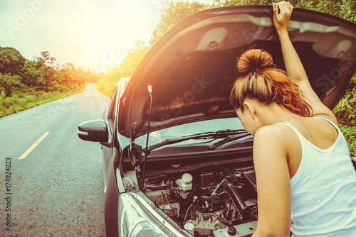 Asian women travel relax in the holiday. Broken car on the street. Thailand