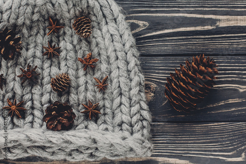 Christmas Anise And Pine Cones On Warm Woolen Hat Rustic Background Top View Space