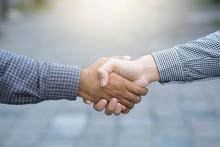 Business Hand Shake Between Tw...