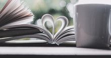 A Book Open In Heart Shape And...