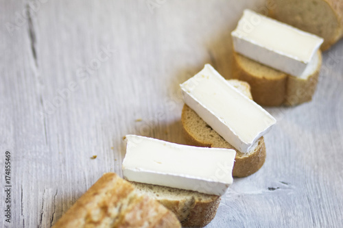A few pieces of sliced baguette with brie cheese