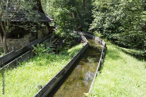 Foto op Canvas Kanaal The wooden water canal at the mill.