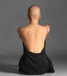 Leinwanddruck Bild - Beautiful bald woman in black dress sitting against grey background