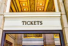 Transportation Tickets Sign Inside Building With Golden Lights