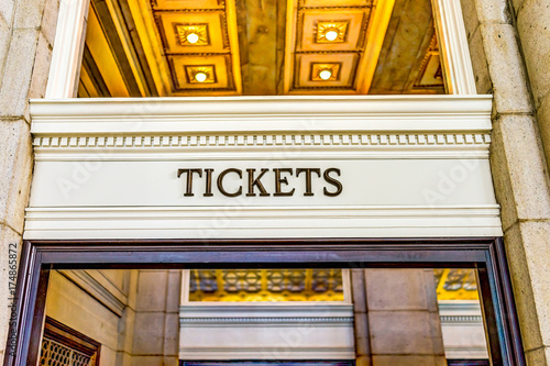 Transportation tickets sign inside building with golden lights Canvas Print