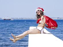 Female In Santa's Hat And Swim...