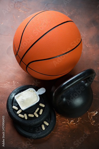 Basketball Ball With Kettlebell Scoop Of Protein And Vitamins On A Rusty Metal Background Vertical Shot Buy This Stock Photo And Explore Similar Images At Adobe Stock Adobe Stock