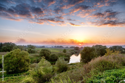 Printed kitchen splashbacks Coast Beautiful sunset overlooking the fields, hills and river. Bright sky and beautiful nature