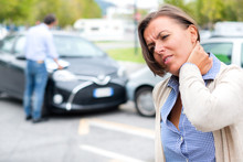 Woman Feeling Pain After Car A...