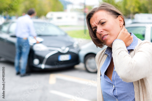 Woman feeling pain after car accident in the city Canvas Print