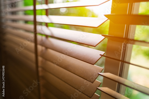 Wooden blinds with sun light. Canvas Print