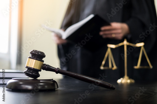 Obraz na plátne  gavel and soundblock of justice law and lawyer working on wooden desk background