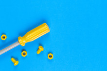 Toys Background. Kids Construction Toys Tools On Light Blue And Yellow Background.