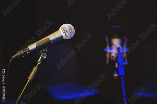 Photo Microphone sing and chorus at concert.