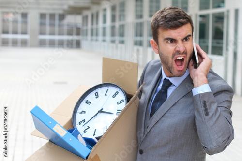 Broke and angry entrepreneur leaving the office building Wallpaper Mural